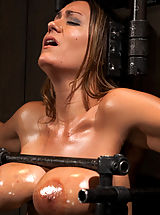 Trina Michaels takes the fuck machine hard and fast. She is gagged, blindfolded, whipped, caned and fingered into orgasm after orgasm.