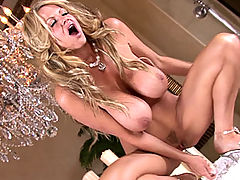 Kelly cums with the soft aura of candle light, she slides a glass dildo in and out of her pussy as she looks in the mirror.