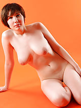 nice tittys, Busty Hope nude and seductively amazing against the orange background
