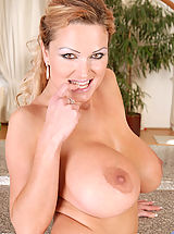 Seductive hot milf Sharon Pink pops out her massive boobs while slowly taking off her sexy thongs