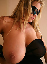 Big.Tits Pics: Kelly was lounging outside in a see thru black wrap that gets to hot to wear.