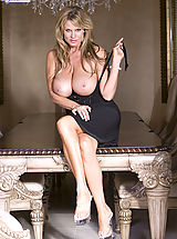 Office Pics: Kelly wears a black dress and plays with her pussy on the dinning room table.