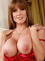 Busty Women, Hot mom Darla Crane is horny and ready to suck and fuck two big cocks at the same time in this threesome.