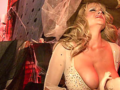 Hot Busty Movies, Kelly wears a see thru nude dress while she makes her witches brew. She pulls it up to satisfy her magical pussy with a clear wand.
