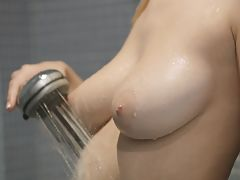 Bouncing Boobs, Big breasted blonde Natalia Star gets wet and wild aiming the shower spray at her horny bald pussy to pleasure her twat
