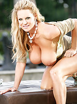 Kelly enjoys the outdoors while banging her pussy with a clear dildo.