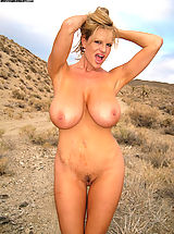 Busty Women, Kelly wears a little black dress and gives a blowjob in the desert.