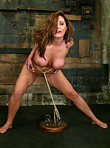 Fetish Pics: Huge boobed Christina Carter is bound and forced to cum.