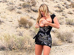 Kelly walks tirelessly through the desert in search of dick she takes her black dress off and gets fucked.
