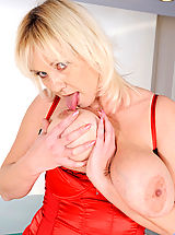 Big.Tits Pics: Kimi, Blonde cougar Kimi flaunts her big tits and plays with her pussy using her fingers