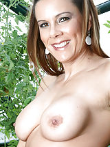 Busty Asian, Brunette Anilos Victoria loves to expose her experienced shaved pussy while she hangs out in her garden